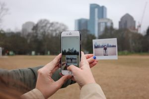 person taking picture of Austin skyline